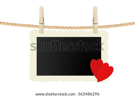 old photo card with red hearts hanging on rope isolated on white background - stock photo