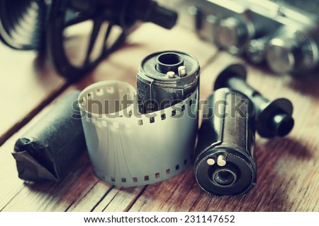 Old photo film rolls, cassette and retro camera. Vintage stylized. - stock photo