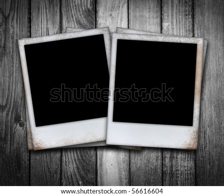 old photo frame on black wooden planks - stock photo