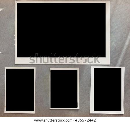 old photo frames in album - stock photo