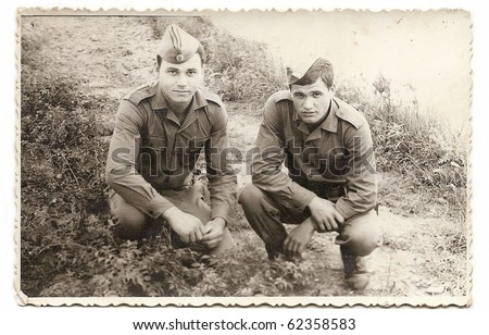 Old photo of two young soldiers - stock photo