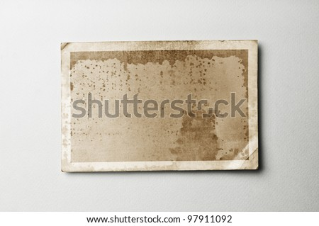 Old photo paper on vintage paper with clipping path for the inside - stock photo