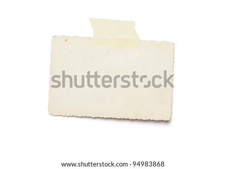 Old photo with adhesive tape isolated on white background - stock photo
