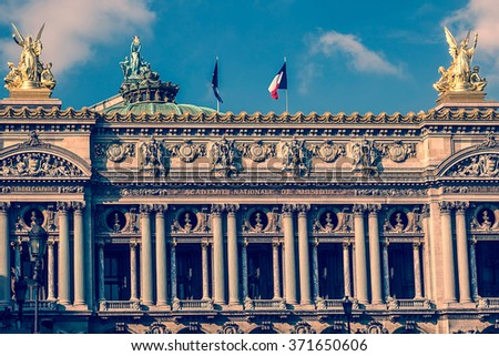Old photo with architectural details of Opera National de Paris: Front Facade. Grand Opera (Garnier Palace) is famous neo-baroque building in Paris, France - UNESCO World Heritage Site. - stock photo