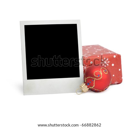 old photograph and a Christmas ball isolated on white - stock photo
