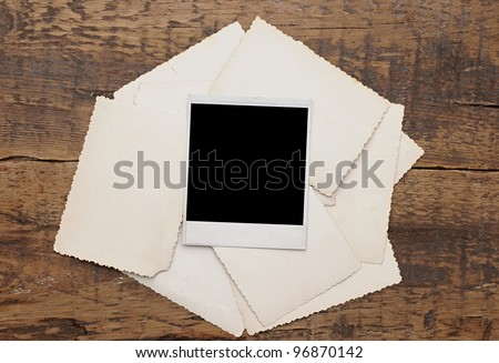 old photos on a wooden background - stock photo