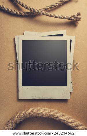 Old photos on antique backdrop - stock photo