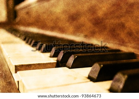 Old piano in vintage finish - stock photo