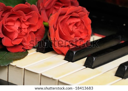 Old Piano with Red  Roses