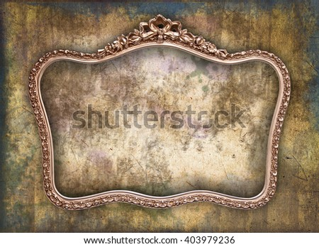 Old picture frame a a grunge wall - stock photo
