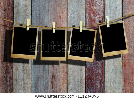 Hanging Pictures old picture frame hanging on clothesline stock photo 111234995