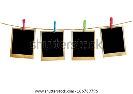 Old picture frame hanging on clothesline white background. - stock photo