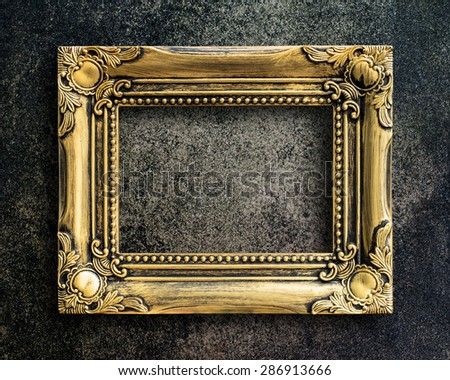 Old picture frame on grunge wall. - stock photo