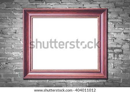 old picture frame on old brick wall background - stock photo