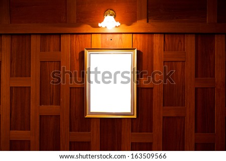Old picture frame on vintage wood wall. - stock photo