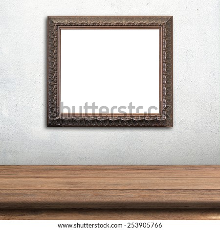 Old picture frame on white wall. - stock photo