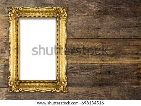 Old Picture Frame on wood baclground, white inside