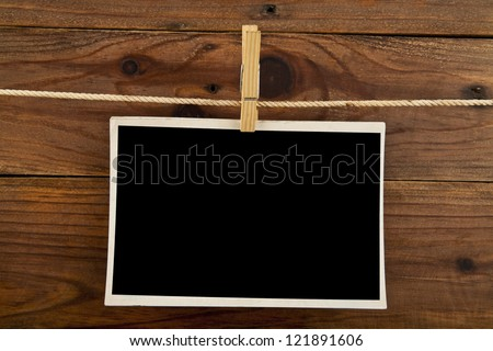 old pictures on a wooden background - stock photo