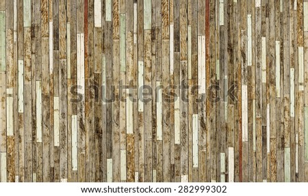old pieces of wood plank arranged as a big wooden wall - stock photo
