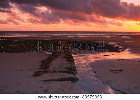 Old pier in Rumpside in Great Britain - stock photo