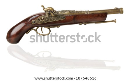 Old pistol on a white background - stock photo