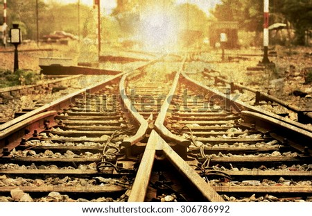 Old piture noise and grain,image retro style.Intersection of old local railroad tracks. - stock photo