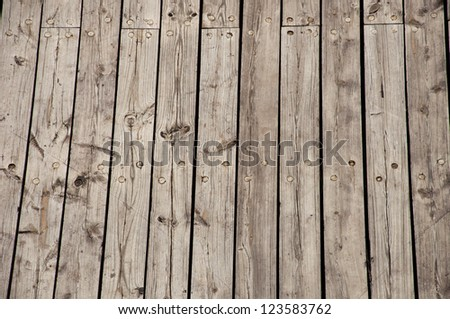 Old planks on a shipping pier - stock photo