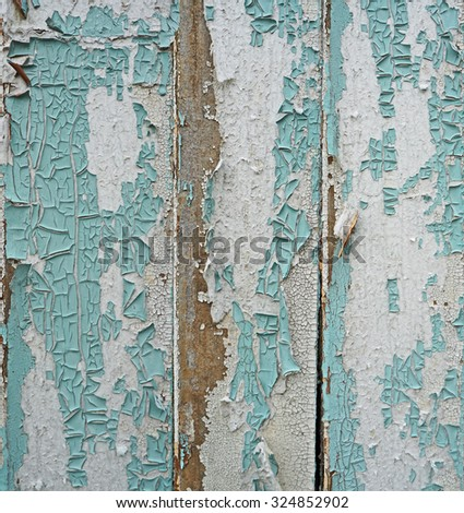 Old planks with peeling paint - stock photo