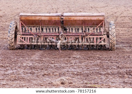 old planter in the field ready for planting seeds - stock photo