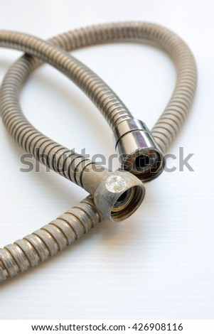 Old plumbing hose pipes - stock photo