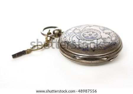 old pocket silver swiss closed watch with key on white - stock photo