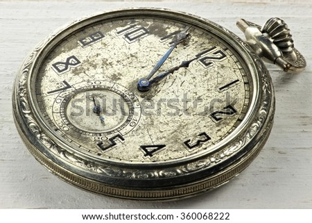 old pocket watch on wooden background - stock photo