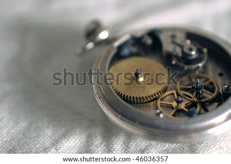 Old pocket watch showing gears