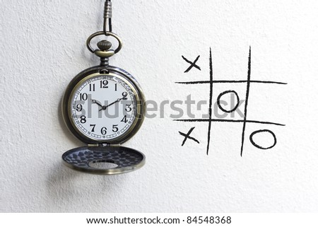 old pocket watches with tic-tac-toe game.