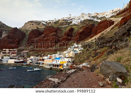 Old port of Oia village at Santorini island in aegean sea, Greece. Santorini is a volcanic island at the Cyclades. - stock photo