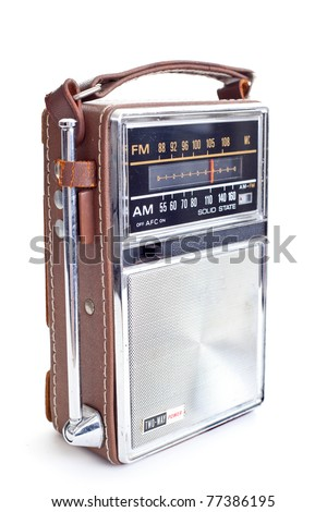 Old portable radio, lots of chrome and leather.  Isolated on white background. - stock photo
