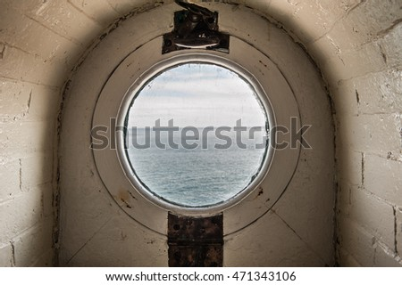 Old porthole in white bricks