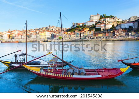 old Porto and traditional boats with wine barrels, Portugal - stock photo