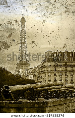 Old postcard with vintage cannons in front of Les Invalides museum and Eiffel tower on background. Paris, France. Vintage processed.