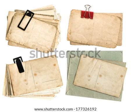 old postcards and envelopes isolated on white background. vintage paper sheets - stock photo