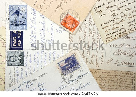 Old postcards with handwriting and stamps from Belgium, South Africa and German Reich. - stock photo