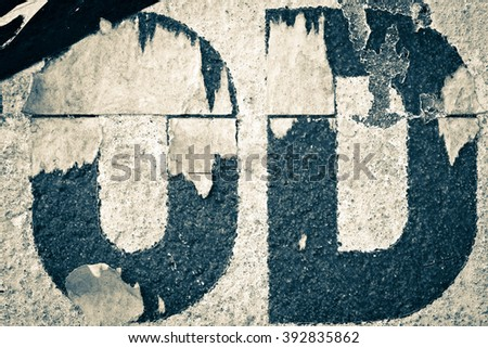 Old posters / Ripped posters / Grunge textures and backgrounds and ripped paper with letters O, D - stock photo
