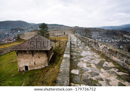 Old Powder Tower built by Bosnians inside the ancient stone fortress on the top of the hill in the city Jajce, Bosnia and Herzegovina.  - stock photo