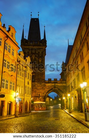 Old Prague street with Charles bridge in the morning