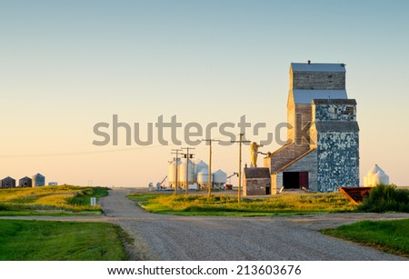 Old prairie elevators with late afternoon light gives a vintage feel. - stock photo