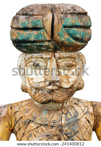 Old primitive carved colorful sculpture of an ancient Oriental soldier isolated on a white background. - stock photo