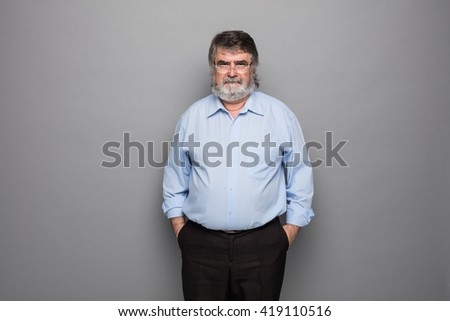 old professor with gray beard and glasses