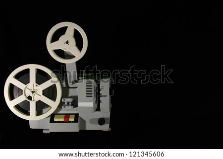 Old projector on a black background