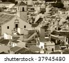 Old, provinicial Spanish town panorama. Colmenar, Andalusia. Created in sepia. - stock photo