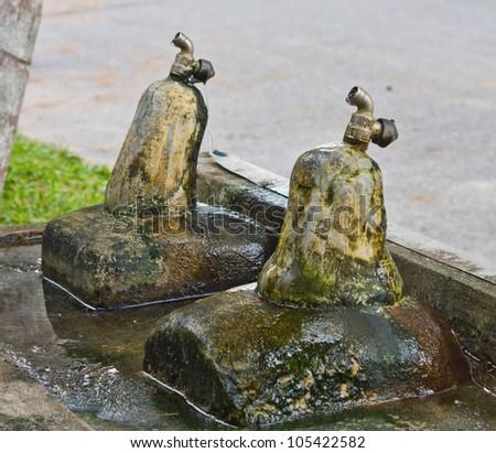 Old public faucet - stock photo